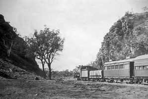 Circa 1930 - Central Australia Railway <em>Ghan</em> -- Heavitree Gap Alice Springs. The car behind the locomotive is the &quot;NRP&nbsp;24&quot;