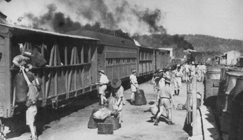 October 1942 - Adelaide River troop train showing converted catle cars and passenger car on North Australia Railway