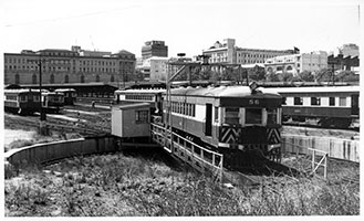 2.1964, railcar brill No. 56 on turntable - railcar depot + view of station - Adelaide