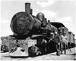 loco SAR T209 being oiled by crew - fireman holding shovel